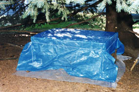 Enclosure Outside View With Tarp